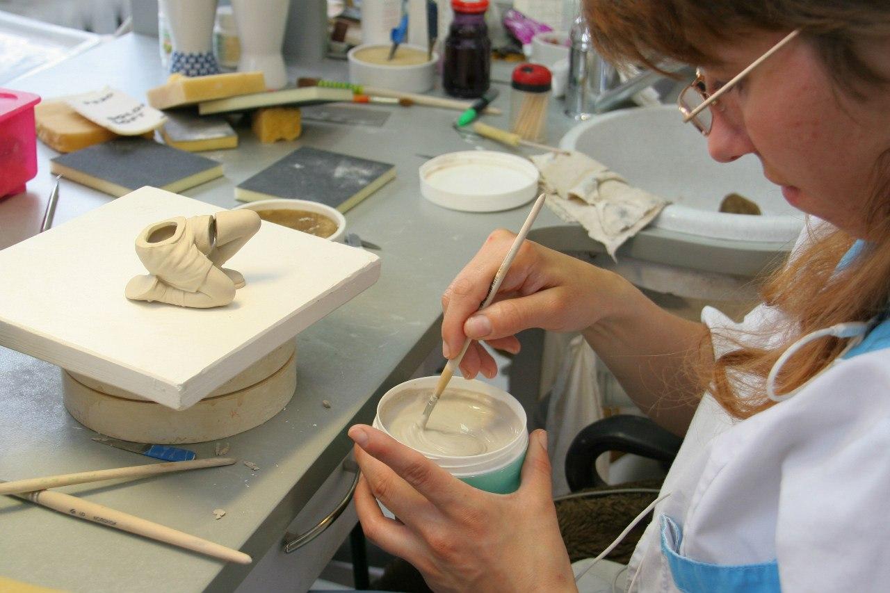 Bonding cast porcelain parts