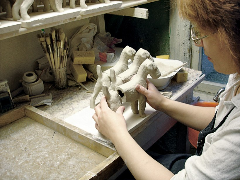The process of bonding cast porcelain parts. Parts the product are stuck together with thicker slurry.